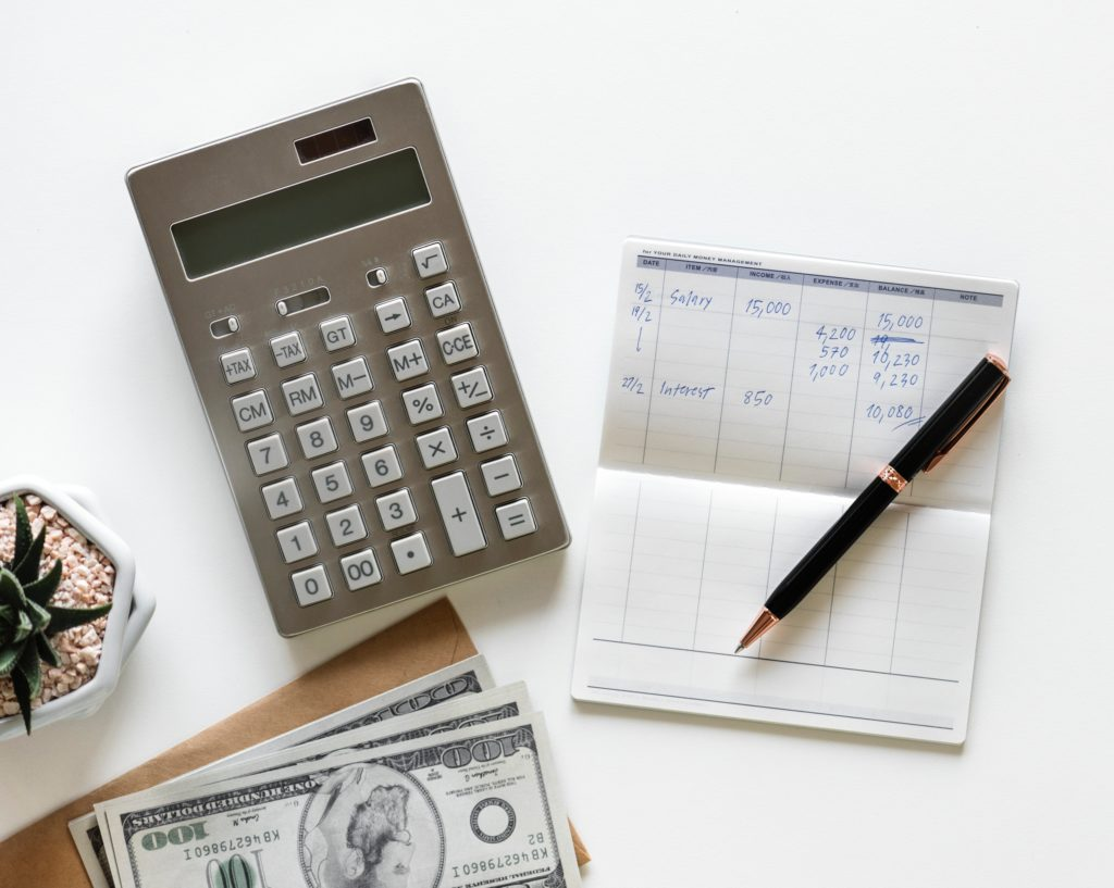 Calculator, Bill, and pen to report billing fraud.