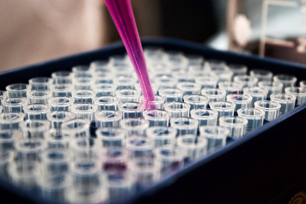 Test tubes in a laboratory setting.  Report cgmp fraud or manufacturing fraud.