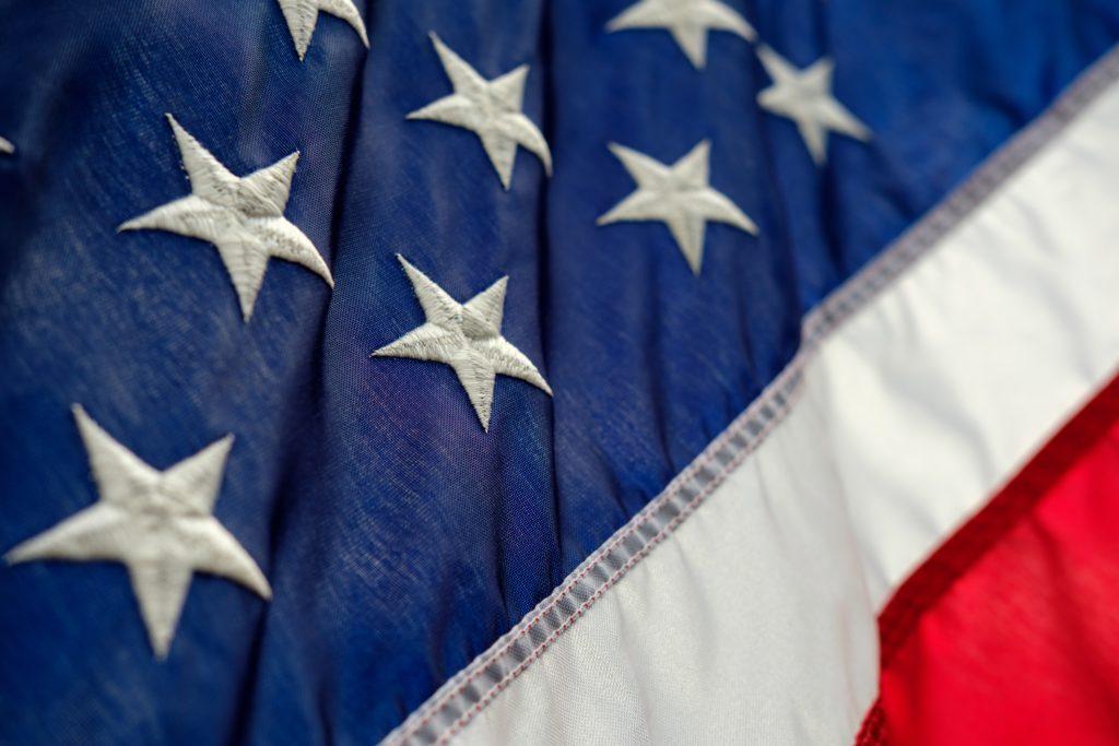 American Flag - below whistleblower information title.