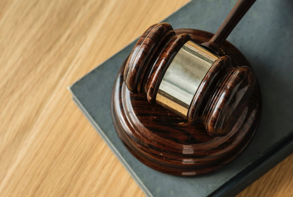 Gavel indicating justice as one of pros and cons of being a whistleblower