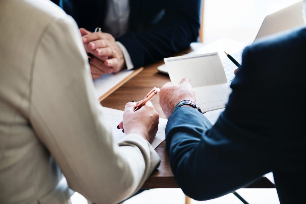 Meeting with business suits and paper to determine what do I want in a qui tam lawyer?