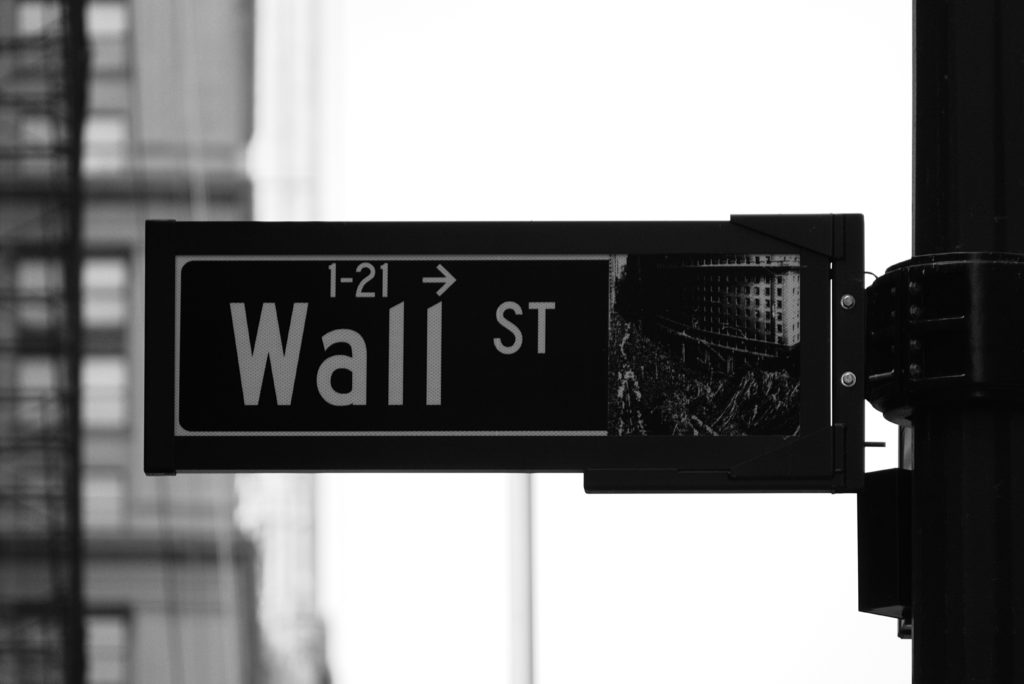Wall Street Sign.  Reporting fraud an SEC Whistleblower anonymity